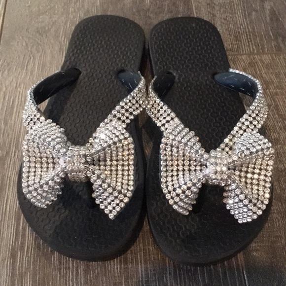 311d88377bea9 Little Girl Black Rhinestone Bow Flip Flops. M 5b54bfbe34e48ad79e957517